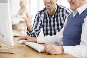 Lecturer helping older man